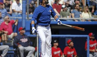 Toronto Blue Jays' Jose Bautista watches his solo home run off Minnesota Twins relief pitcher Glen Perkins during the fourth inning of a spring training baseball game in Dunedin, Fla., Saturday, March 8, 2014.  (AP Photo/Kathy Willens)