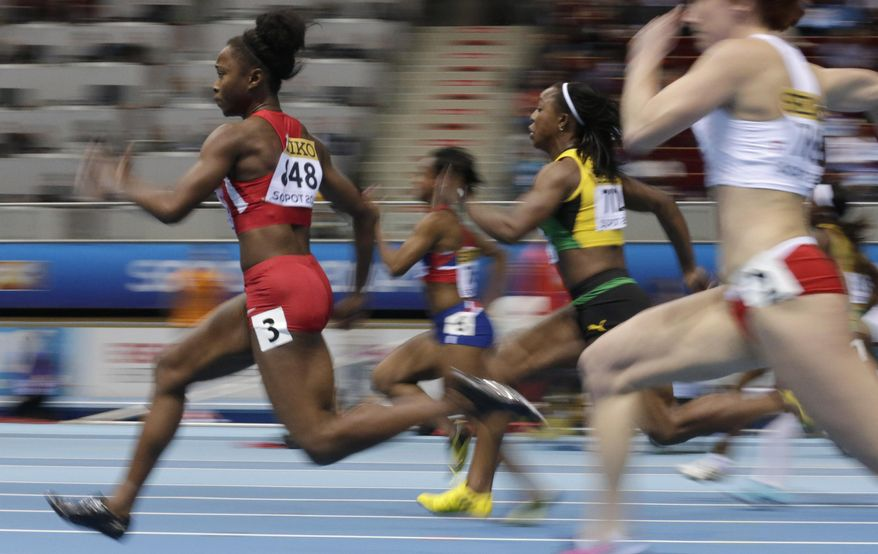 United States' Tianna Bartoletta, left, and Jamaica's Veronica Campbell-Brown compete in a  women's 60m heat during the Athletics Indoor World Championships in Sopot, Poland, Saturday, March 8, 2014.  (AP Photo/Matt Dunham)