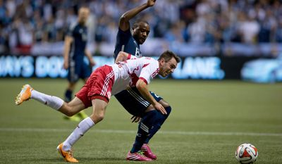 Vancouver Whitecaps' Nigel Reo-Coker, back, of England, and New York Red Bulls' Eric Alexander vie for the ball during first half MLS soccer action in Vancouver, B.C., on Saturday March 8, 2014.   (AP Photo/The Canadian Press, Darryl Dyck)