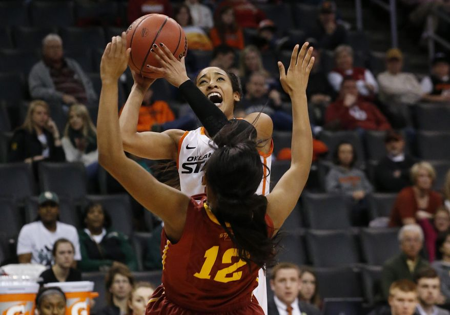 Oklahoma State guard Tiffany Bias (3) fouls Iowa State guard Seanna Johnson (12) as she shoots in the first half of an NCAA college basketball game in the quarterfinals of the Big 12 Conference women's basketball tournament in Oklahoma City, Saturday, March 8, 2014. (AP Photo/Sue Ogrocki)