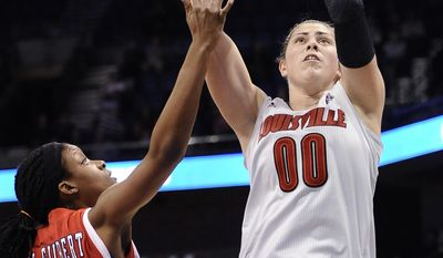 Louisville's Sara Hammond, right, shoots over Houston's Tyler Gilbert during the first half of an NCAA college basketball game in the quarterfinals of the American Athletic Conference women's tournament, Saturday, March 8, 2014, in Uncasville, Conn. (AP Photo/Jessica Hill)