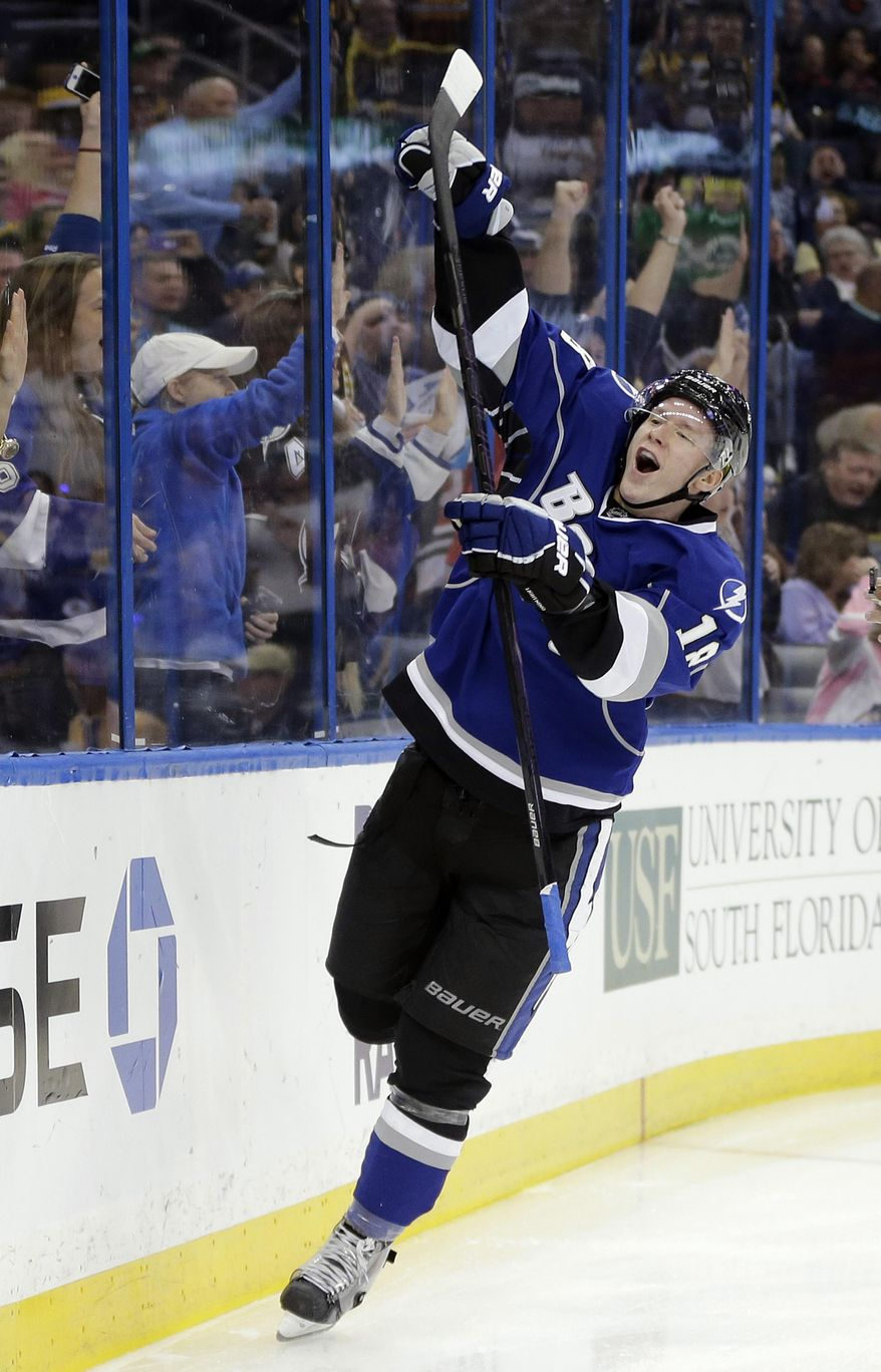 Tampa Bay Lightning left wing Ondrej Palat (18), of the Czech Republic, celebrates his goal against the Boston Bruins during the second period of an NHL hockey game on Saturday, March 8, 2014, in Tampa, Fla. (AP Photo/Chris O'Meara)