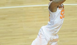 Tennessee guard Jordan McRae (52) scores on a reverse dunk while being fouled by Missouri guard Jabari Brown during the second half of an NCAA basketball game at Thompson-Boling Arena in Knoxville, Tenn., on Saturday, March 8, 2014. Tennessee won 72-45. (AP Photo/Knoxville News Sentinel, Adam Lau)