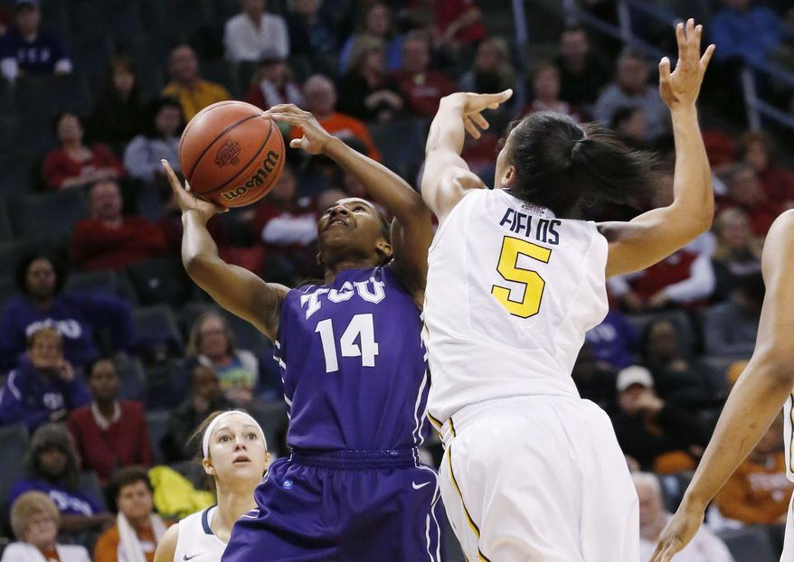 TCU guard Zahna Medley (14) shoots as West Virginia forward Averee Fields (5) defends during the second half of an NCAA college basketball game in the quarterfinals of the Big 12 Conference women's tournament in Oklahoma City, Saturday, March 8, 2014. West Virginia won 67-59. (AP Photo/Sue Ogrocki)