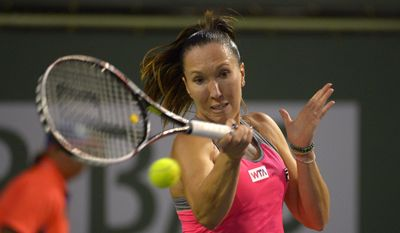 Jelena Jankovic, of Serbia, returns a shot to Yvonne Meusburger, of Austria, during their match at the BNP Paribas Open tennis tournament on Friday, March 7, 2014, in Indian Wells, Calif. (AP Photo/Mark J. Terrill)