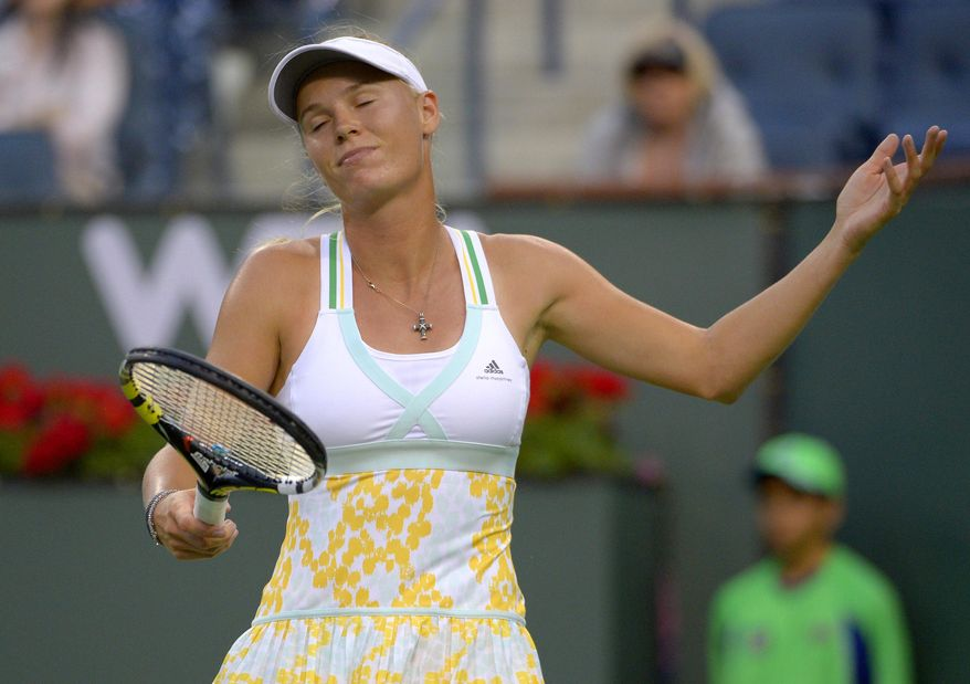 Caroline Wozniacki, of Denmark, reacts to losing a point to Bojana Jovanovski, of Serbia, during a second-round match at the BNP Paribas Open tennis tournament on Friday, March 7, 2014, in Indian Wells, Calif. (AP Photo/Mark J. Terrill)