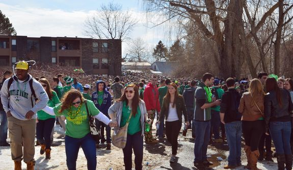 "People gather for the pre-St. Patrick's Day ""Blarney Blowout"" near the University of Massachusetts in Amherst, Mass. on Saturday, March 8, 2014. According to the Amherst police department, four police officers were hurt as they worked to disperse hundreds of unruly students who were throwing beer cans and bottles at police on Saturday as large crowds gathered at the off-campus apartment complex. (AP Photo/The Republican, Robert Rizzuto)"