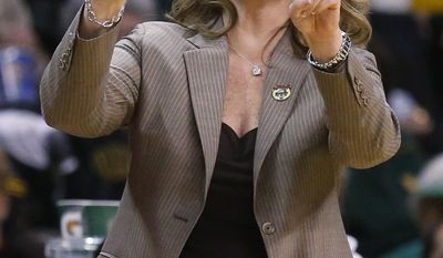 Kansas head coach Bonnie Henrickson gestures in the first half of an NCAA college basketball game in the quarterfinals of the Big 12 Conference women's basketball tournament in Oklahoma City, Saturday, March 8, 2014. (AP Photo/Sue Ogrocki)