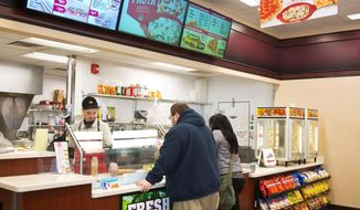 ADVANCE FOR USE SATURDAY, MARCH 8, 2014, AND THEREAFTER - This March 4, 2014,  Michael Newland, left, makes sandwiches for customers Nick Rada and Amber Williams at Casey's General Store in Omaha, Neb. The convenience store chain has been successful serving the small-town niche, with nearly 60 percent of its stores in communities of fewer than 5,000 people. (AP Photo/The World-Herald, Ryan Soderlin) MAGS OUT; ALL NEBRASKA LOCAL BROADCAST TV OUT
