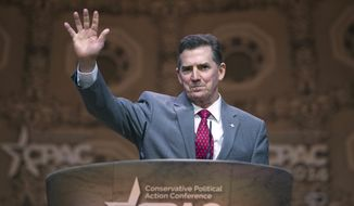 Heritage Foundation President Jim DeMint waves while addressing the Conservative Political Action Conference annual meeting in National Harbor, Md., Saturday, March 8, 2014. Saturday marks the third and final day of the annual Conservative Political Action Conference, which brings together prospective presidential candidates, conservative opinion leaders and tea party activists from coast to coast. (AP Photo/Cliff Owen)