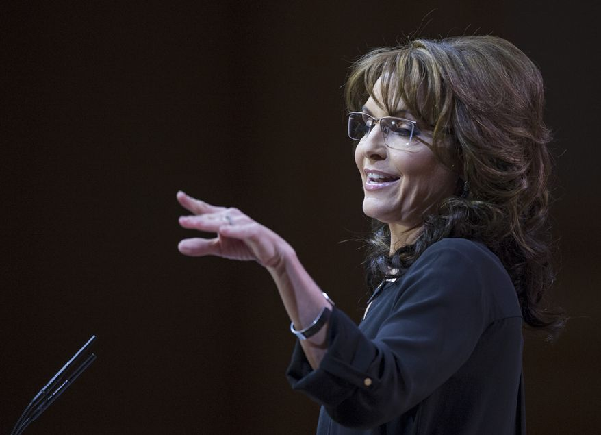 ** FILE ** Former Alaska governor and 2008 Republican vice presidential nominee Sarah Palin gestures while she addresses the Conservative Political Action Committee annual conference in National Harbor, Md., Saturday, March 8, 2014. (AP Photo/Cliff Owen)