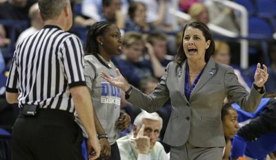 Duke head coach Joanne P McCallie, right, argues a call during the first half of an NCAA college basketball semi-final game against North Carolina at the Atlantic Coast Conference tournament in Greensboro, N.C., Saturday, March 8, 2014. (AP Photo/Chuck Burton)