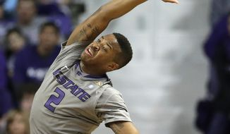 Kansas State's Marcus Foster tries to control the ball after being fouled during the first half of an NCAA college basketball game against Baylor Saturday, March 8, 2014, in Manhattan, Kan. (AP Photo/Charlie Riedel)