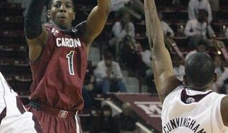 South Carolina's Brenton Williams (1) shoots over the outstretched arm of Mississippi State's Tyson Cunningham (24) during the second half of an NCAA college basketball game in Starkville, Miss., Saturday, March 8, 2014. South Carolina won 74-62. (AP Photo/Jim Lytle)