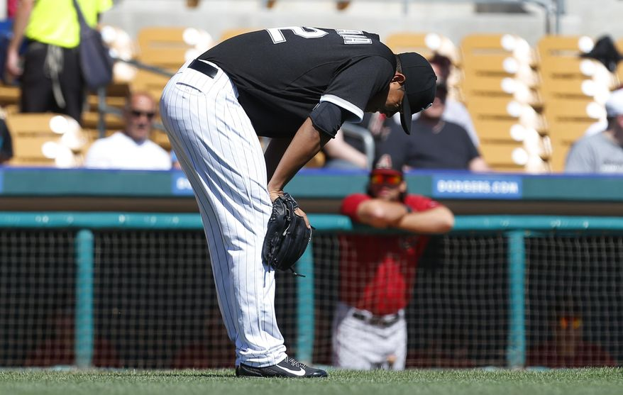 Chicago White Sox pitcher Jose Quintana reacts to being hit by a Arizona Diamondbacks Gerardo Parra hit in the first inning during an exhibition baseball game in Glendale, Ariz., Saturday, March 8, 2014. Quintana left the game after the play. (AP Photo/Paul Sancya)