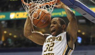 Wichita State's Tekele Cotton (32) dunks against Missouri State in the second half of an NCAA college basketball game in the semifinals of the Missouri Valley Conference men's tournament, Saturday, March 8, 2014, in St. Louis. (AP Photo/Bill Boyce)