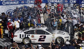 Brad Keselowski celebrates in victory lane after winning a NASCAR Sprint Cup Series auto race, Sunday, March 9, 2014, in Las Vegas. (AP Photo/Isaac Brekken)