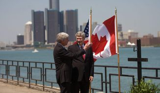 FILE - In this June 15, 2012 file photo, Canada Prime Minister Stephen Harper right, and Michigan Governor Rick Snyder chat on the banks of the Detroit River in Windsor, Ontario, Canada.  The omission in the federal budget for funding specifically for a border inspection plaza in Michigan is not expected to delay efforts to build a commuter bridge connecting Detroit with Canada, state officials say. Land acquisition for the New International Trade Crossing could start this summer on the U.S. side of the Detroit River, with bridge construction scheduled to begin in 2016. The project would be completed in 2020. The span would compete for the lucrative cross-border toll revenues in Detroit and Windsor, Ont., mainly being captured by the privately owned Ambassador Bridge.  (AP Photo/The Canadian Press,Mark Spowart )