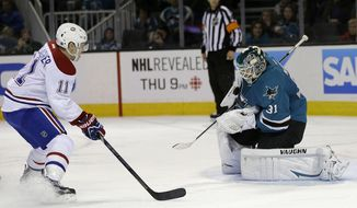 San Jose Sharks goalie Antti Niemi (31), of Finland, stops a shot from Montreal Canadiens right wing Brendan Gallagher (11) during the second period of an NHL hockey game Saturday, March 8, 2014, in San Jose, Calif. (AP Photo/Tony Avelar)