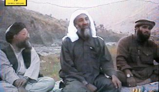 In this undated photo provided by the United States Attorney's Office for the Southern District of New York,  defendant Suliman Abu Ghayth, right, is seated with  al Qaida founder Osama Bin Laden, center, and Bin Laden's deputy, Ayman al Zawahiri, in Afghanistan. Suliman Abu Ghayth, is being tried in New York, charged with plotting to kill Americans by being a motivational speaker at al Qaida training camps before the Sept. 11 attacks and as a spokesman for the terror group afterward when it sought to recruit more militants to its cause. (AP Photo/U.S. Attorney's Office for the Southern District of New York)