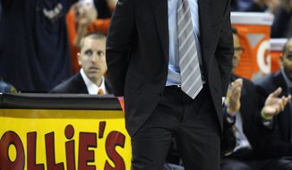 Virginia head coach Tony Bennett reacts during the second half of an NCAA college basketball game against Maryland, Sunday, March 9, 2014, in College Park, Md. Maryland won 75-69 in overtime. (AP Photo/Nick Wass)