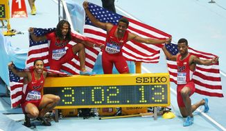 United States relay team with Kind Butler, David Verburg, Calvin Smith and Kyle Clemons, from left, celebrate after winning the 4x400m relay with a new world record during the Athletics World Indoor Championships in Sopot, Poland, Sunday, March 9, 2014. (AP Photo/Petr David Josek)