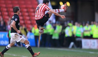 Sheffield United's Ryan Flynn scores their first goal of the game against Charlton Athletic during the FA Cup Sixth Round match at Bramall Lane, Sheffield, England, Sunday March 9, 2014. (AP Photo/Nick Potts, PA) UNITED KINGDOM OUT - NO SALES - NO ARCHIVES