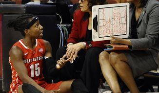 Rutgers' Syessence Davis, left, talks with head coach C. Vivian Stringer, center, and assistant coach Tia Jackson during the second half of an NCAA college basketball game against Connecticut in the semifinals of the American Athletic Conference women's tournament on Sunday, March 9, 2014, in Uncasville, Conn. Connecticut won 83-57. (AP Photo/Jessica Hill)