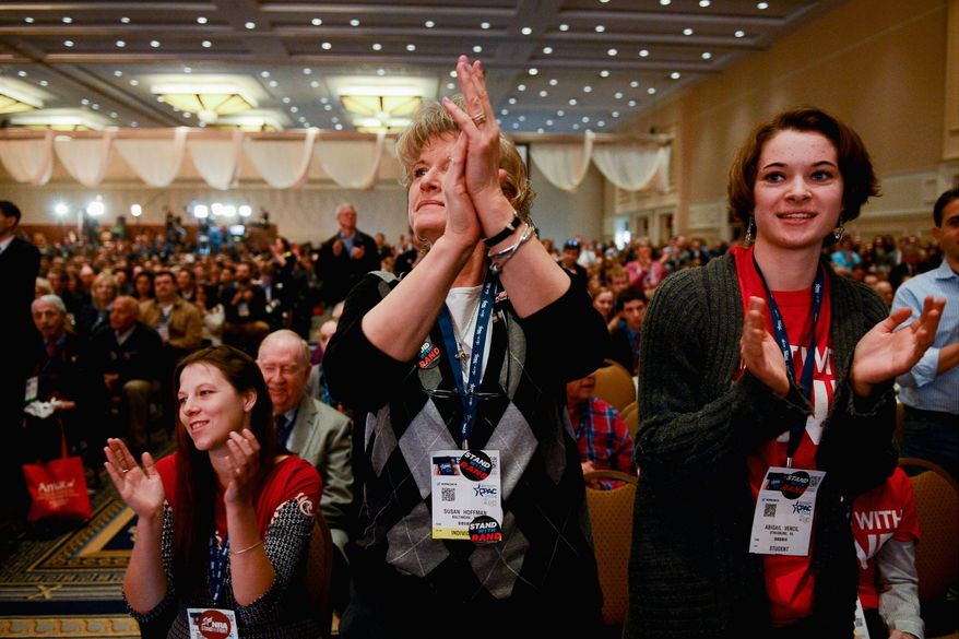 The crowd at the Conservative Political Action Conference cheers Sen. Rand Paul on Friday. The Kentucky Republican easily won the straw poll, but Sen. Ted Cruz, Texas Republican and another tea party favorite, could pose a serious challenge. (Andrew Harnik/The Washington Times)