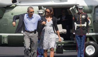 President Obama and first lady Michelle Obama return to Washington after spending the weekend in Florida. (Associated Press)