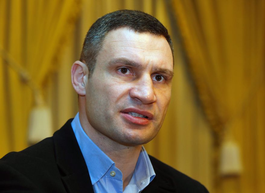 "Packing a punch: ""Our task today is to save Ukraine, save peace and sovereignty, unity and integrity, to build a new country,"" says Vitali Klitschko, a serious contender to lead his country. (Associated Press)"