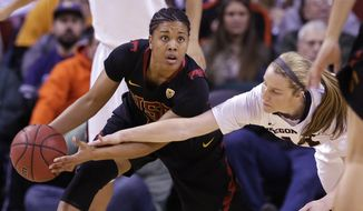 Southern California's Ariya Crook, left, looks for room to pass as Oregon State's Ali Gibson defends in the first half of the Pac-12 NCAA college championship basketball game Sunday, March 9, 2014, in Seattle. (AP Photo/Elaine Thompson)