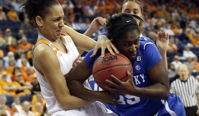 Tennessee forward Cierra Burdick, left, and Kentucky guard Linnae Harper (15) fights for a rebound in the first half of the finals of the Women's Southeastern Conference NCAA college basketball game, Sunday, March 9, 2014, in Duluth, Ga. (AP Photo/Jason Getz)