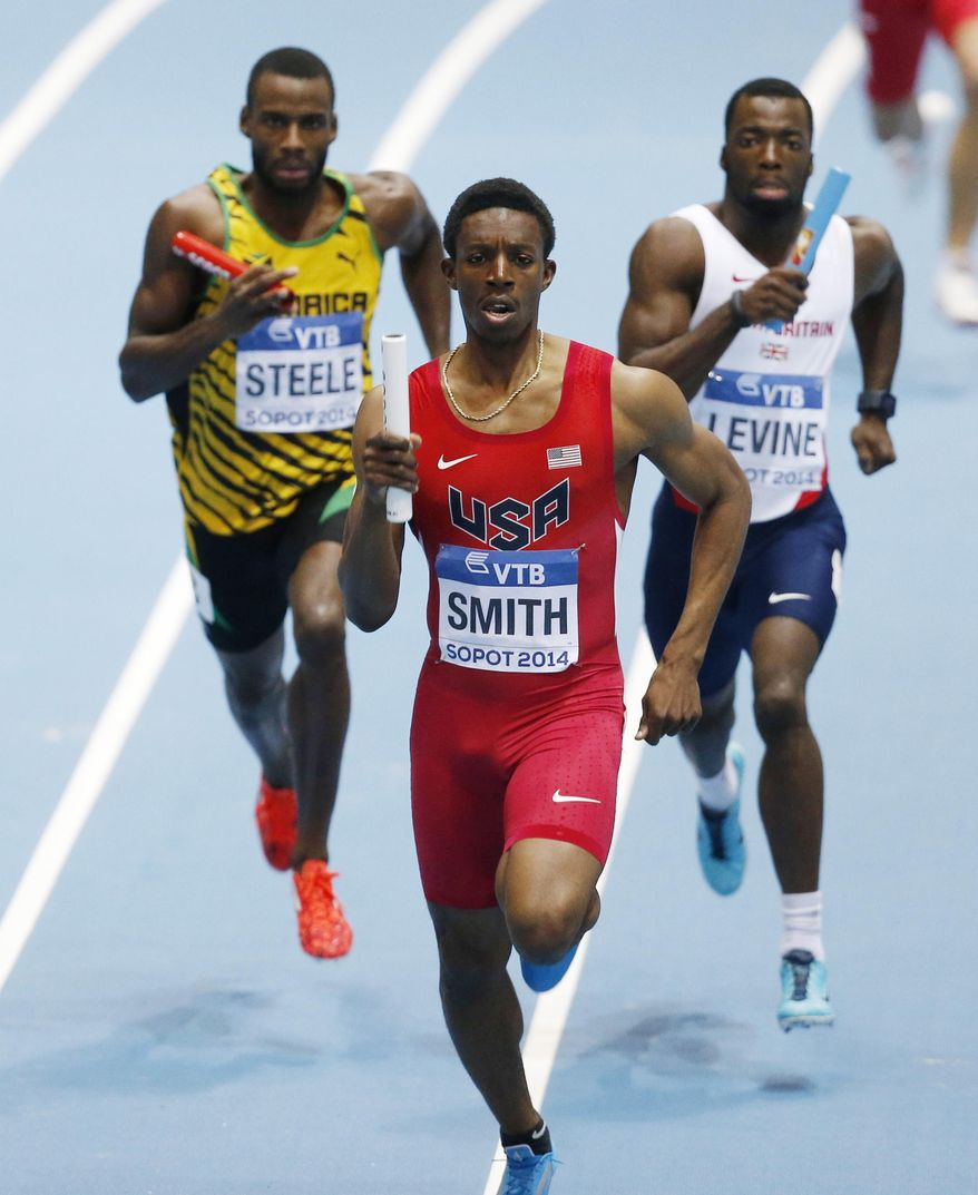 United States' Calvin Smith leads Jamaica's Edino Steele, left, and Britain's Nigel Levine to win the men's 4x400m relay final during the Athletics World Indoor Championships in Sopot, Poland, Sunday, March 9, 2014. (AP Photo/Petr David Josek)