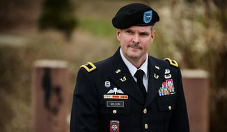 ** FILE ** In this March 4, 2014, file photo, Brig. Gen. Paul Wilson leaves the courthouse after testifying in pretrial motions in the case of Brig. Gen. Jeffrey Sinclair at Fort Bragg, N.C. (AP Photo/The Fayetteville Observer, James Robinson)
