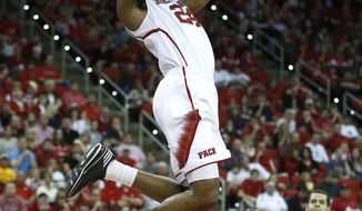 N.C. State's T.J. Warren (24) slams in two on an alley-oop during the first half of N.C. State's game against Boston College at PNC Arena in Raleigh, N.C., Sunday, March 9, 2014. (AP Photo/The News & Observer, Ethan Hyman)