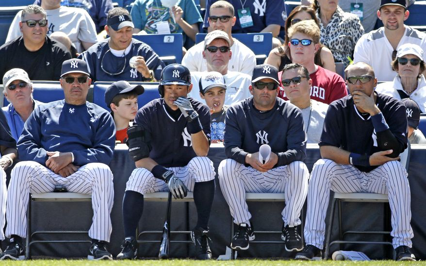 From left to right, New York Yankees Hall-of-Famer and special adviser Reggie Jackson, Yankees' Ichiro Suzuki, Yankees' hitting coach Kevin Long, and Yankees' Derek Jeter watch a spring training baseball game against the Tampa Bay Rays in Tampa, Fla., Sunday, March 9, 2014.  (AP Photo/Kathy Willens)