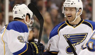 St. Louis Blues defenseman Carlo Colaiacovo (13), right, is congratulated by St. Louis Blues right wing Vladimir Tarasenko (91) after a goal on Minnesota Wild goalie Ilya Bryzgalov (30) during the first period of their NHL hockey game Sunday, March 9, 2014 in St. Paul, Minn..(AP Photo/Andy Clayton-King)