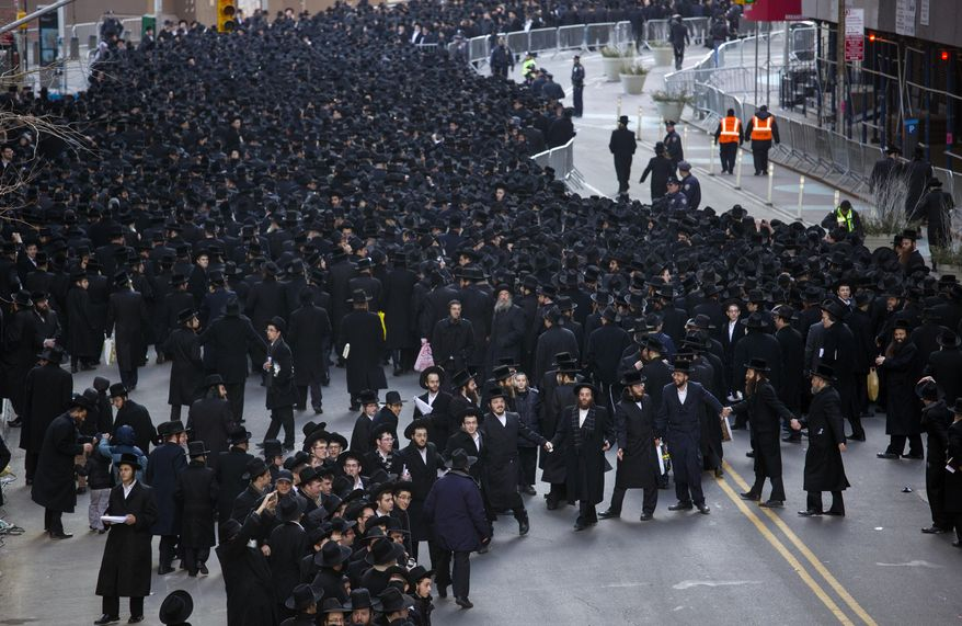 A dance circle is formed after thousands of Orthodox Jews gathered in New York, Sunday, March 9, 2014, on Water Street in lower Manhattan, to pray and protest against the Israeli government's proposal to pass a law that would draft strictly religious citizens into its army. (AP Photo/Craig Ruttle)
