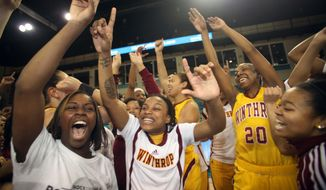 Winthrop Eagles basketball team celebrates beating High Point at the Big South Conference chanpionship 87-74 at a NCAA college basketball in Conway, S.C. on, Sunday, March 9, 2014. (AP Photo/Willis Glassgow)