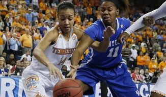 Tennessee's Andraya Carter, left, and Kentucky's DeNesha Stallworth battle for a loose ball in the first half of an NCAA college basketball game in the finals of the Southeastern Conference women's basketball tournament Sunday, March 9, 2014, in Duluth, Ga. (AP Photo/John Bazemore)