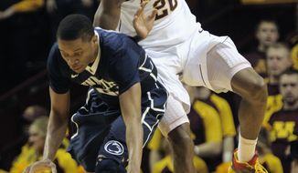 Minnesota's Austin Hollins, right, lands on the back of Penn State's Tim Frazier as Frazier attempts to bring the ball upcourt during the first half of an NCAA college basketball game on Sunday, March 9, 2014, in Minneapolis. (AP Photo/Tom Olmscheid)