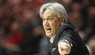 New Mexico coach Craig Neal tries to rally his team during the second half of New Mexico 51-48 loss to San Diego State in a NCAA college basketball game Saturday, March 8, 2014, in San Diego. The loss gave San Diego State the Mountain West Conference regular season championship.  (AP Photo/Lenny Ignelzi )