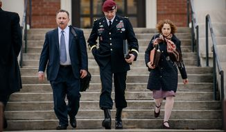 ** FILE ** In this March 4, 2014, file photo, Brig. Gen. Jeffrey Sinclair leaves the courthouse with his lawyers Richard Scheff, left, and Ellen C. Brotman, following a day of motions at Fort Bragg, N.C. (AP Photo/The Fayetteville Observer, James Robinson)