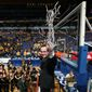 Wichita State head coach Gregg Marshall waves to fans after cutting down the net after the Missouri Valley Conference tournament championship NCAA basketball game between Wichita State and Indiana State on Sunday, March 9, 2014, at the Scottrade Center in St. Louis.  (AP Photo/St. Louis Post-Dispatch, Chris Lee)  EDWARDSVILLE INTELLIGENCER OUT; THE ALTON TELEGRAPH OUT   MBI