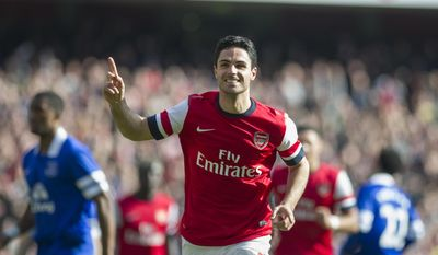 Arsenal's Mikel Arteta celebrates, after scoring against Everton, during their FA Cup quarterfinal soccer match, at Emirates Stadium, in London, Saturday, March 8, 2014. (AP Photo/Bogdan Maran)