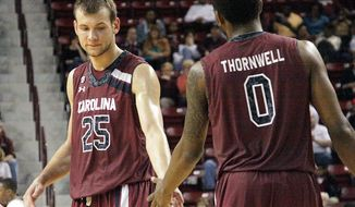 South Carolina players Mindaugas Kacinas (25) and Sindarius Thornwell (0) congratulate each other on their win over Mississippi State in an NCAA college basketball game in Starkville, Miss., Saturday, March 8, 2014. (AP Photo/Jim Lytle)