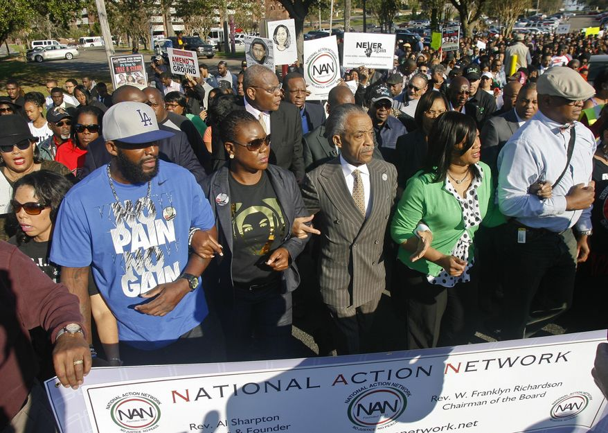 """From left, participants including Lucia McBath, mother of Jordan Davis, Tracy Martin and Sybrina Fulton, parents of Trayvon Martin, Rev. Al Sharpton, president of National Action Network, and Phyllis Giles, mother of Michael Giles, march to the Florida Capitol Monday, March 10, 2014, in Tallahassee, Fla. Participants were rallying against the state's """"Stand Your Ground"""" laws. (AP Photo/Phil Sears)"""