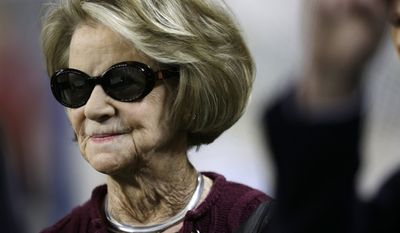"FILE - This Dec. 22, 2013 file photo shows Martha Ford, wife of Detroit Lions owner William Clay Ford,  on the sidelines before an NFL football game between the Lions and New York Giants in Detroit. The Lions announced Monday, March 10, 2014, that Ford's interest in the team passes to Martha Ford, pursuant to ""long-established succession plans."" William Clay Ford died Sunday. The 88-year-old Ford was the last surviving grandchild of automotive pioneer Henry Ford. (AP Photo/Carlos Osorio, File)"