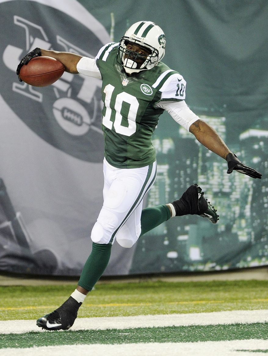 FILE - In this Sept. 22, 2013 file photo, New York Jets wide receiver Santonio Holmes (10) celebrates after scoring a touchdown during the second half of an NFL football game against the Buffalo Bills,  in East Rutherford, N.J.  The Jets have parted ways with Holmes, cutting the talented but injury-plagued playmaker after four seasons. The move Monday, March 10, 2014, which had been expected, saves the Jets $8.25 million, which Holmes was due to make as his base salary this season. (AP Photo/Bill Kostroun, File)